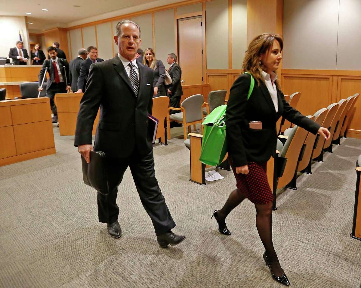 Special prosecutors Brian Wice and Nicole DeBorde leave a courtroom after a hearing involving AG Ken Paxton.