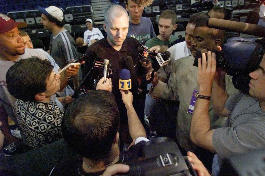 Head Coach Gregg Popovich of the San Antonio Spurs is surrounded by the media as he answers questions after his team's workout June 17, 1999, at the Alamodome in San Antonio.  The Spurs beat the Knicks 89-77 in Game 1 of the NBA Finals to take a 1-0 lead in the best-of-seven series. Photo: Robert Sullivan | AFP, Getty Images