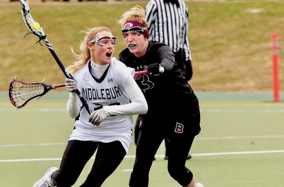 Hollis Perticone lifts the periscope, on the lookout for an open teammate on the attack. / Will C Images,LLC
