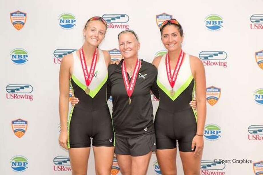 Julia Cornacchia (right), coach Liz Trond and Kaitlyn Kynast all take gold for their efforts in the two-boat.
