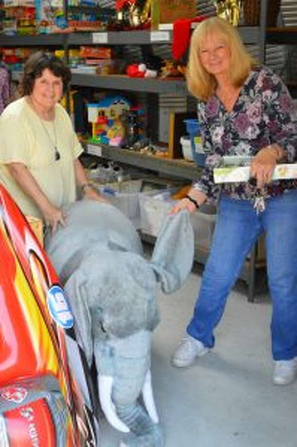 Visitors get friendly with the Swap Shop's toy collection