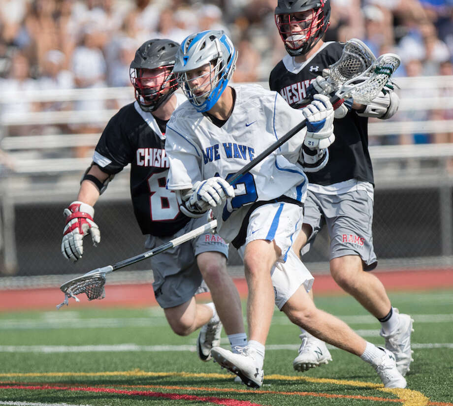 Kevin Lindley takes his game to the net in his final appearance for Darien at the state final in early June. Courtesy Darien Athletic Foundation / (c)Mark Maybell