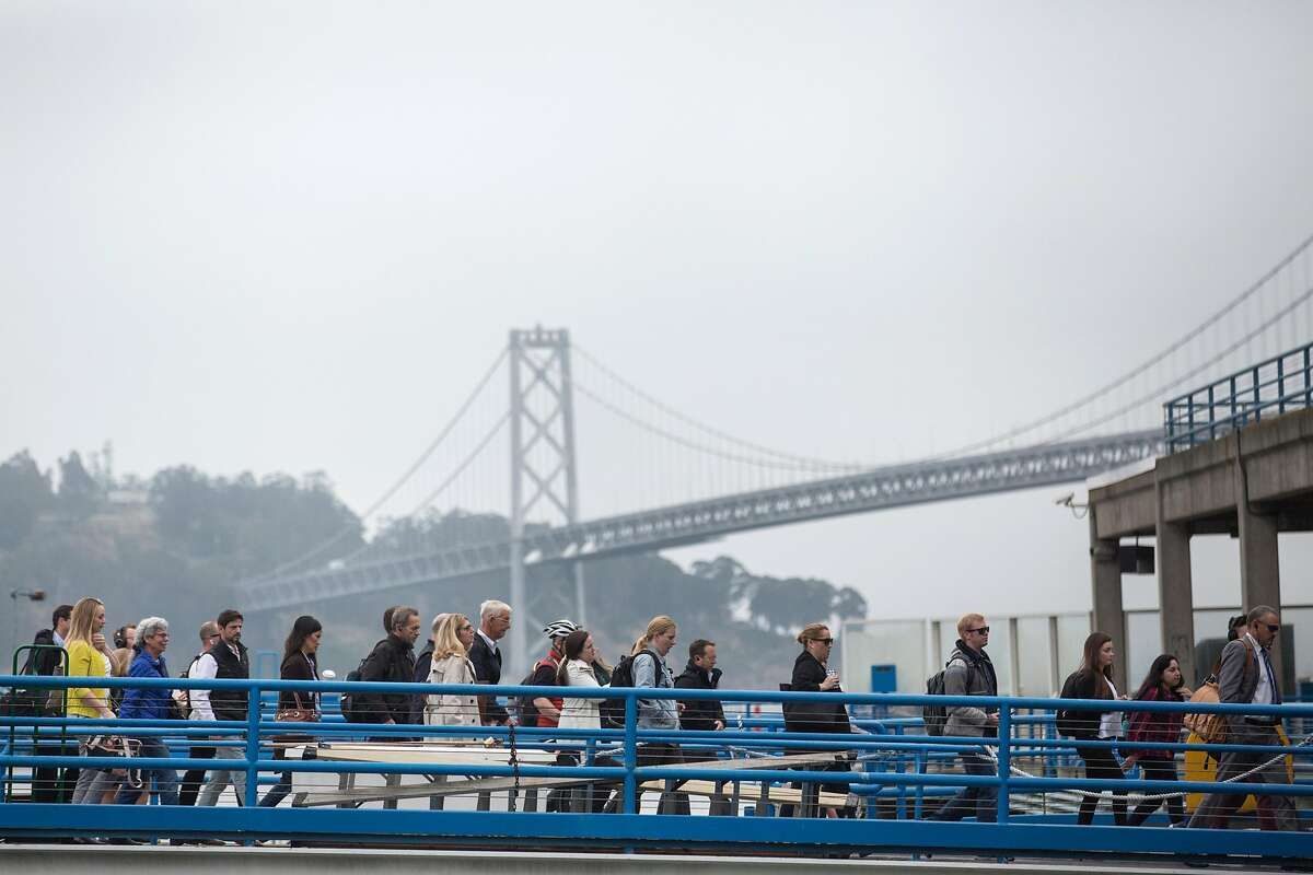 Commuters getting off the Golden Gate transit ferry at the Ferry Building on Wednesday, June 19, 2019. San Francisco, Calif.