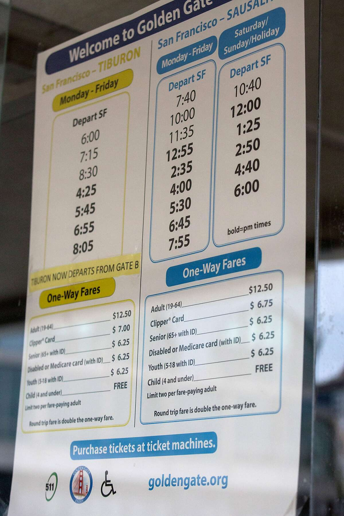 Poster listing schedule and pricing for the Golden Gate transit ferry. Wednesday, June 19, 2019. San Francisco, Calif.