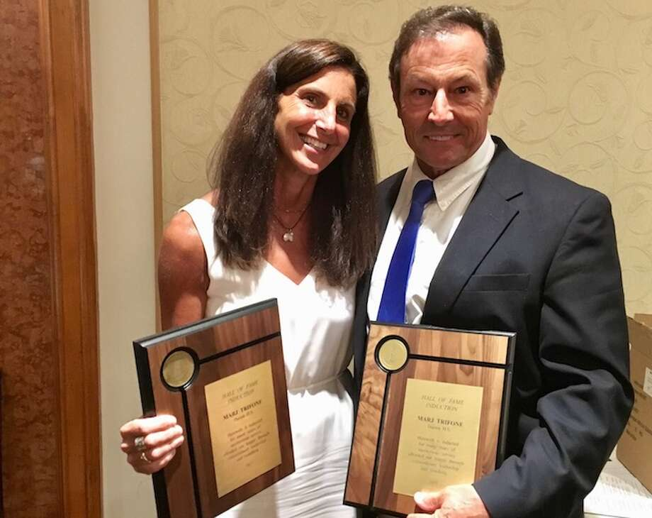 Marj and Rob Trifone with their respective honorary FCIAC Hall of Fame plaques.