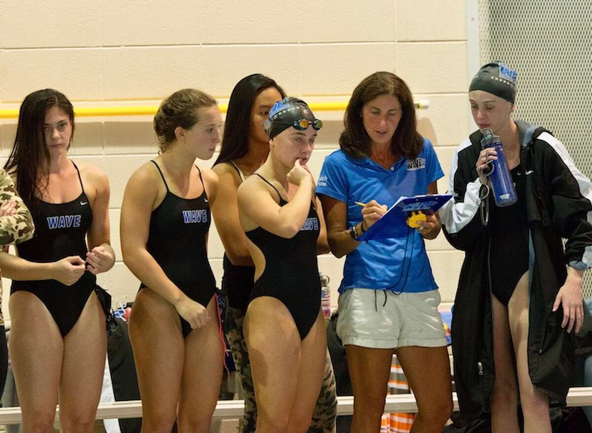 Marj Trifone keeps track of the proceedings at a 2015 meet. Courtesy Darien Athletic Foundation