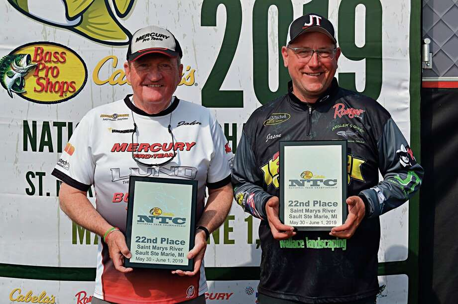 Jason Maraskine of Midland, right, and angling partner John Allen of Mansfield, Ohio, celebrate their 22nd-place finish and All-American honors at the Bass Pro Shops and Cabela's National Team Championships in Sault Ste. Marie, Mich., on June 1.