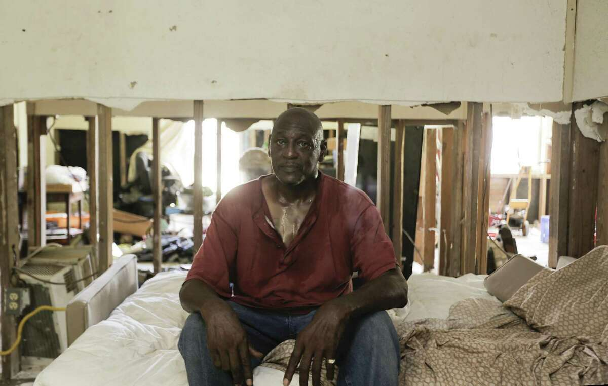 Joe Fowler sits in a bed he sometimes naps on with his son in his Kashmere Gardens home on Tuesday, June 18, 2019 in Houston. The home took in three feet of water and Fowler is still in the process of trying to secure funds.