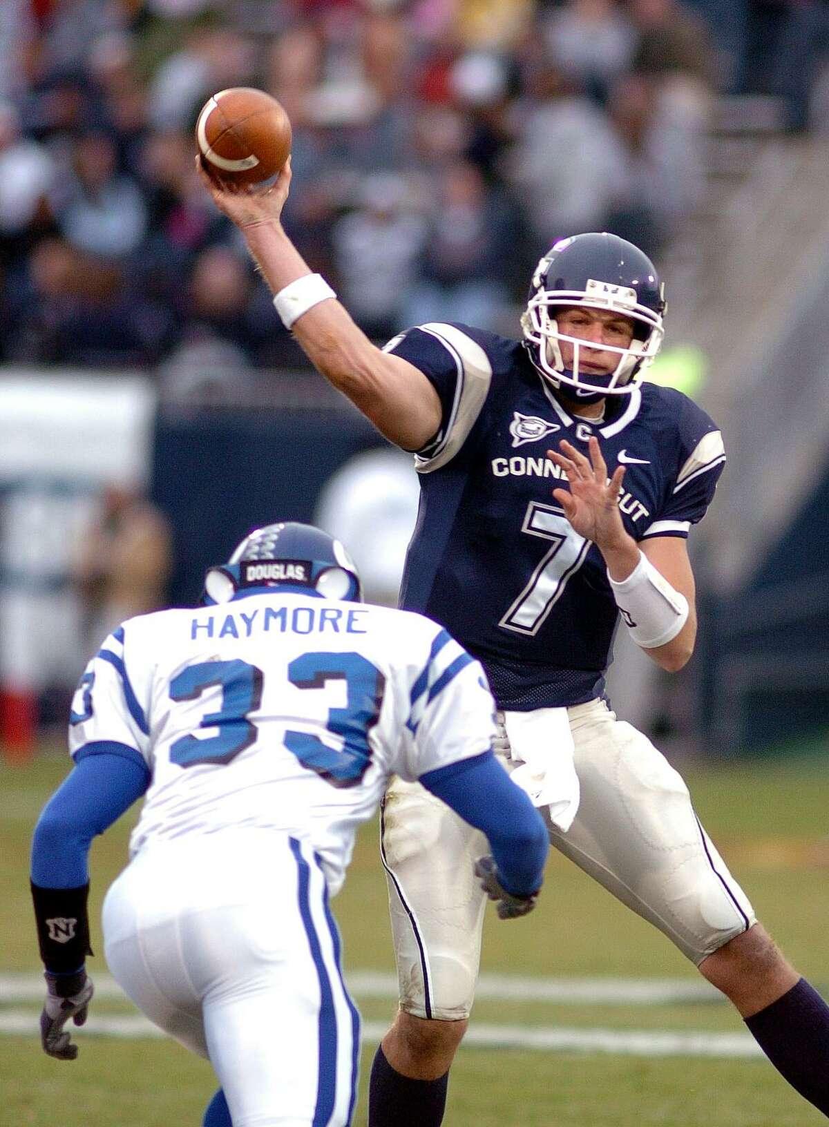UConn quarterback Dan Orlovsky completes a pass as Buffalo's Laron Haymore defends in a November 2004 game.