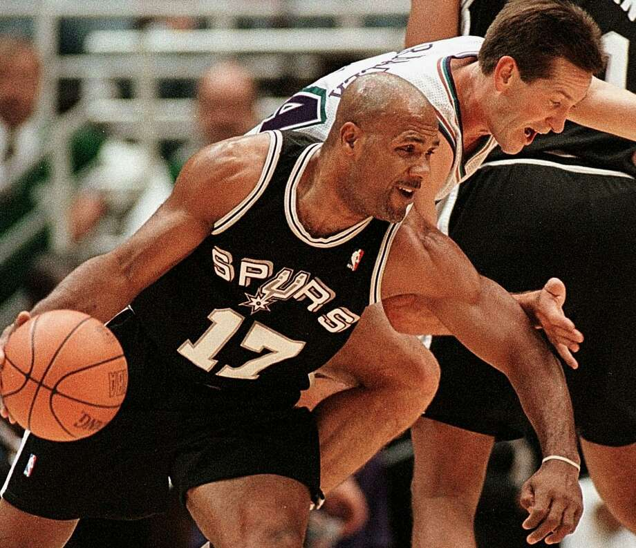 Mario Elie of the San Antonio Spurs tries to drive past Jeff Hornacek of the Utah Jazz Nov. 15, 1999, in Salt Lake City. Photo: George Frey | AFP, Getty Images