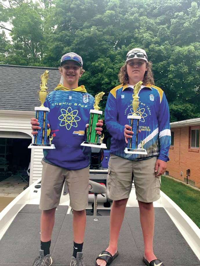 Midland High students Brady Pinwar, left, and Alec Albrecht pose with the trophies they earned at The Bass Federation of Michigan's 2019 Junior State Tournament on June 9 at Lake Ponemah near Fenton.