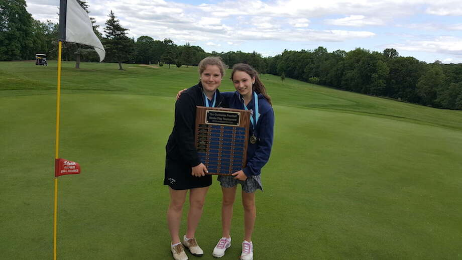 Bridget Wolters (left) and Emily Cohen sporting the trophy once again this spring.