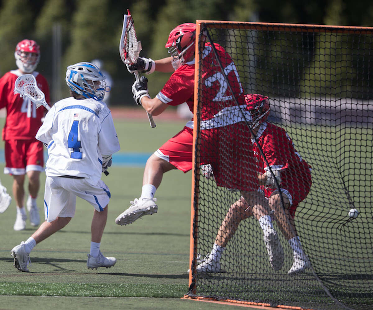 Logan McGovern scores behind-the-back goal in quarterfinals on Saturday. Courtesy Darien Athletic Foundation