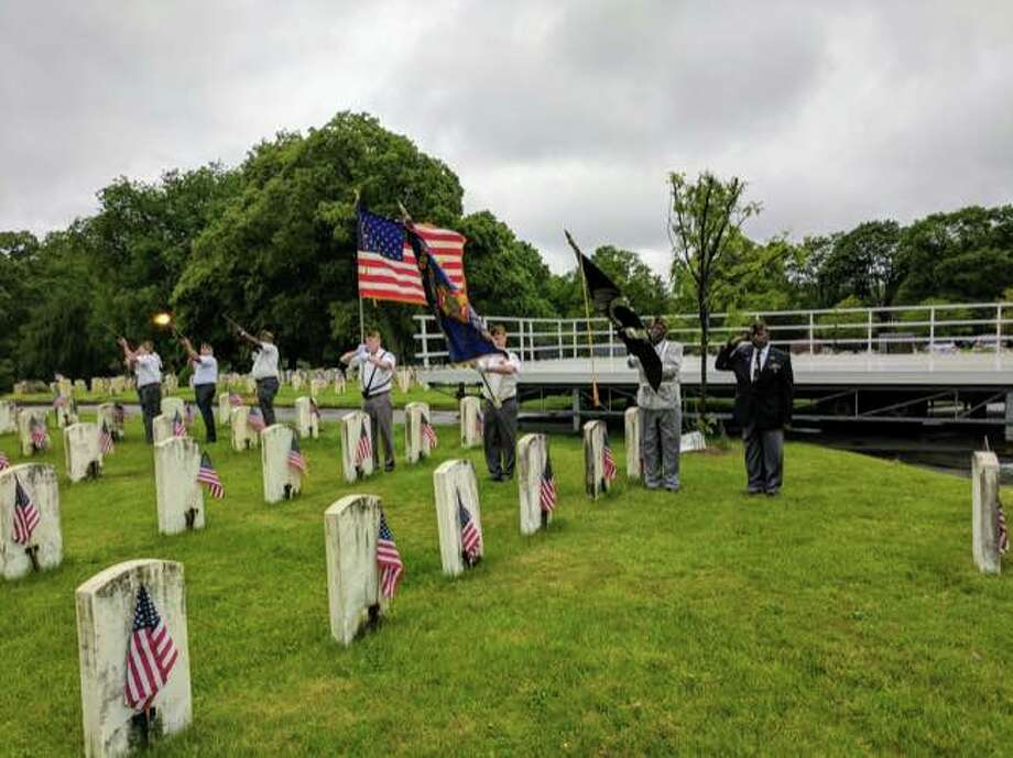 A firing squad salute, with honor guard, to fallen veterans