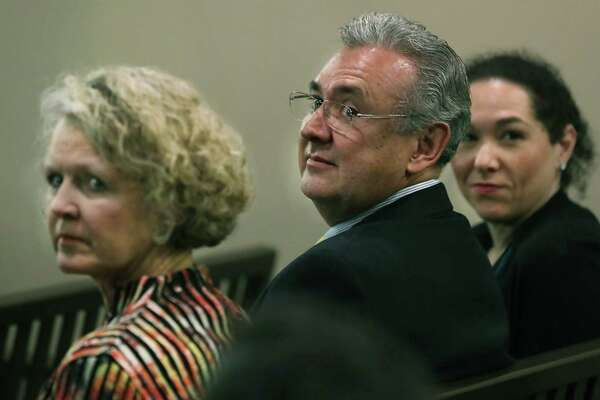Catherine Babbitt, from left, Bexar County DA Joe Gonzales, and Nicole Perez, all from Gonzales's office, are seen in the 226th District Court in the Cadena-Reeves Justice Center, on Monday, June 17, 2019, for hearing to disqualify LaHood's firm from defending a family violence suspect.