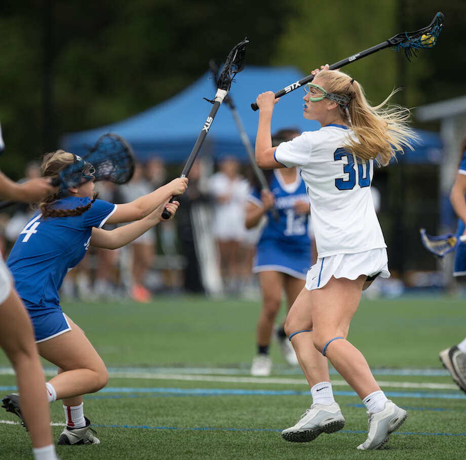 Charlotte Wittstock moves in against Southington in the state tournament first round. Courtesy Darien Athletic Foundation / (c)Mark Maybell