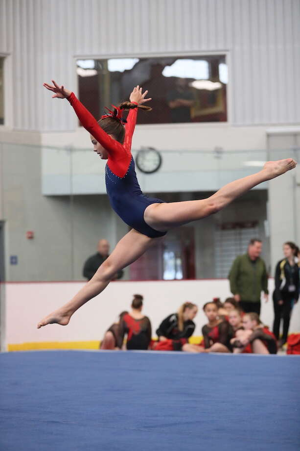 Darien YMCA Level 5 gymnast Anna Primmer displayed grace in motion on floor at the YMCA Northeast Regional Championships in Maine.