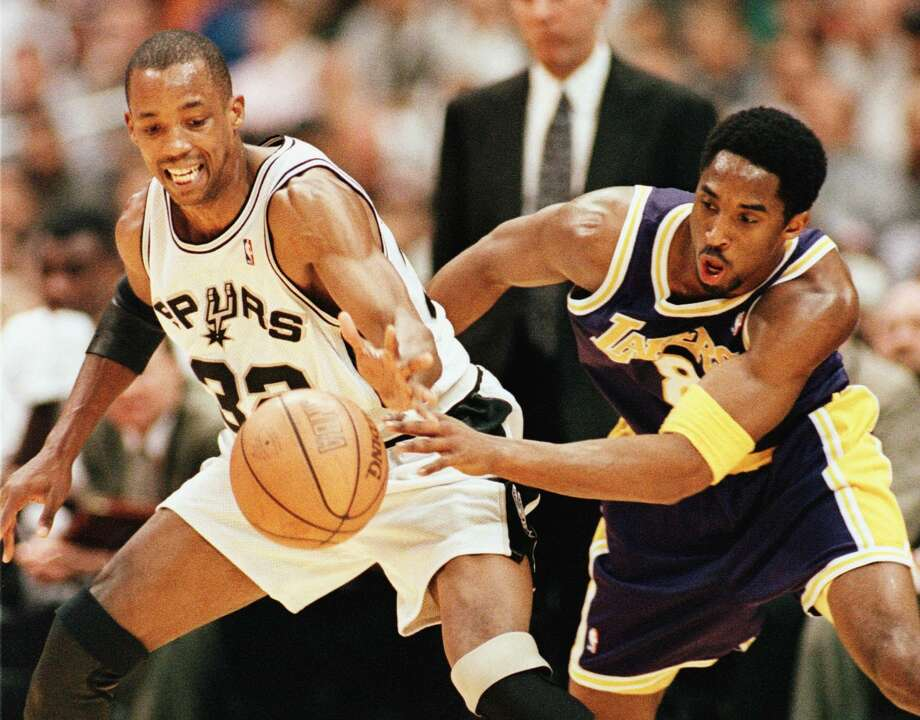 San Antonio Spur Sean Elliott and Los Angeles Laker Kobe Bryant fight for the basketball during first quarter action in Game 1 of the Western Conference semifinal May 17, 1999, at the Alamodome. Photo: Paul Buck | AFP, Getty Images
