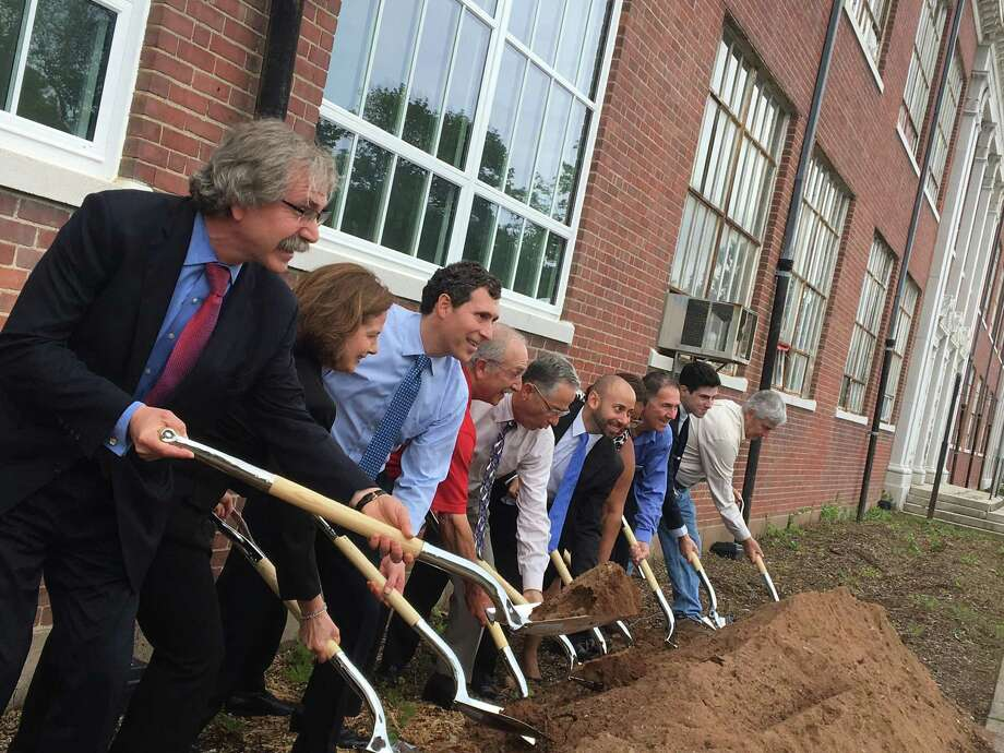 "Officials from the Town of East Haven and developer WinnDevelopment of Boston broke ground Wednesday, June 19, 2019 on a $21.5 million ""adaptive reuse"" project to convert the 83-year-old former East Haven High School building at 200 Tyler St. to 70 mixed-income apartments for seniors in the front and a community center with meeting space, a theater, gym and a renovated pool in back. Less than a week later, the town, acting at the request of the East Shore District Health Department, temporarily shut down the demolition project so a sanitarian could investigate neighborhood complaints about rat activity. The developer got the go ahead to proceed with demolition on Thursday, June 27, 2019. Photo: Mark Zaretsky / Hearst Connecticut Media /"