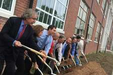 """Officials from the Town of East Haven and developer WinnDevelopment of Boston broke ground Wednesday, June 19, 2019, on a $21.5 million """"adaptive reuse"""" project to convert the 83-year-old former East Haven High School building at 200 Tyler St. to 70 mixed-income apartments for seniors in the front and a community center with meeting space, a theater, gym and a renovated pool in back"""