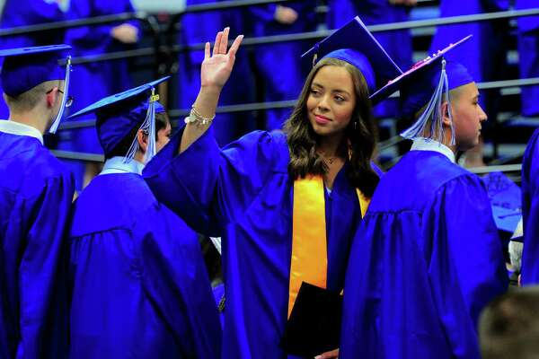 Graduate Ingrid Silva waves to family after getting her diploma during Abbot Tech's Commencement Exercises at at the O'Neill Center at Western Connecticut State University in Danbury, Conn., on Wednesday June 19, 2019.
