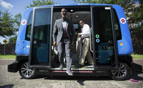 Texas Southern University President Austin A. Lane steps off the Metropolitan Transit Authority autonomous shuttle at the TSU campus on June 19. The shuttle will be the first deployment of autonomous vehicles for public transit use in the Houston area.
