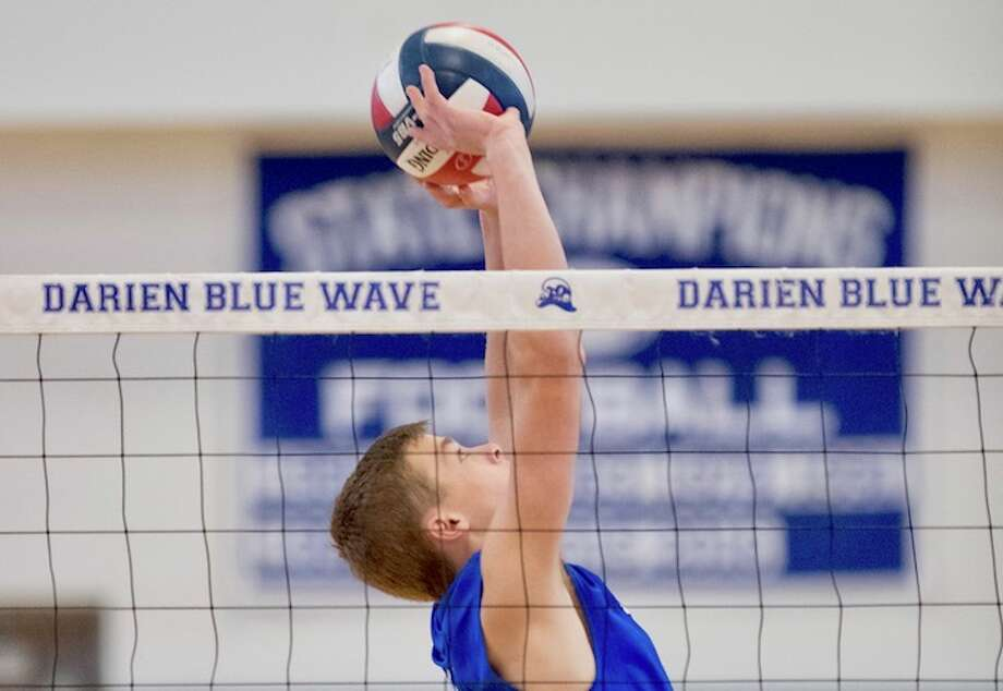Tim Herget makes the play at the net, more times than you can count, every match. Courtesy Darien Athletic Foundation / (c)Mark Maybell