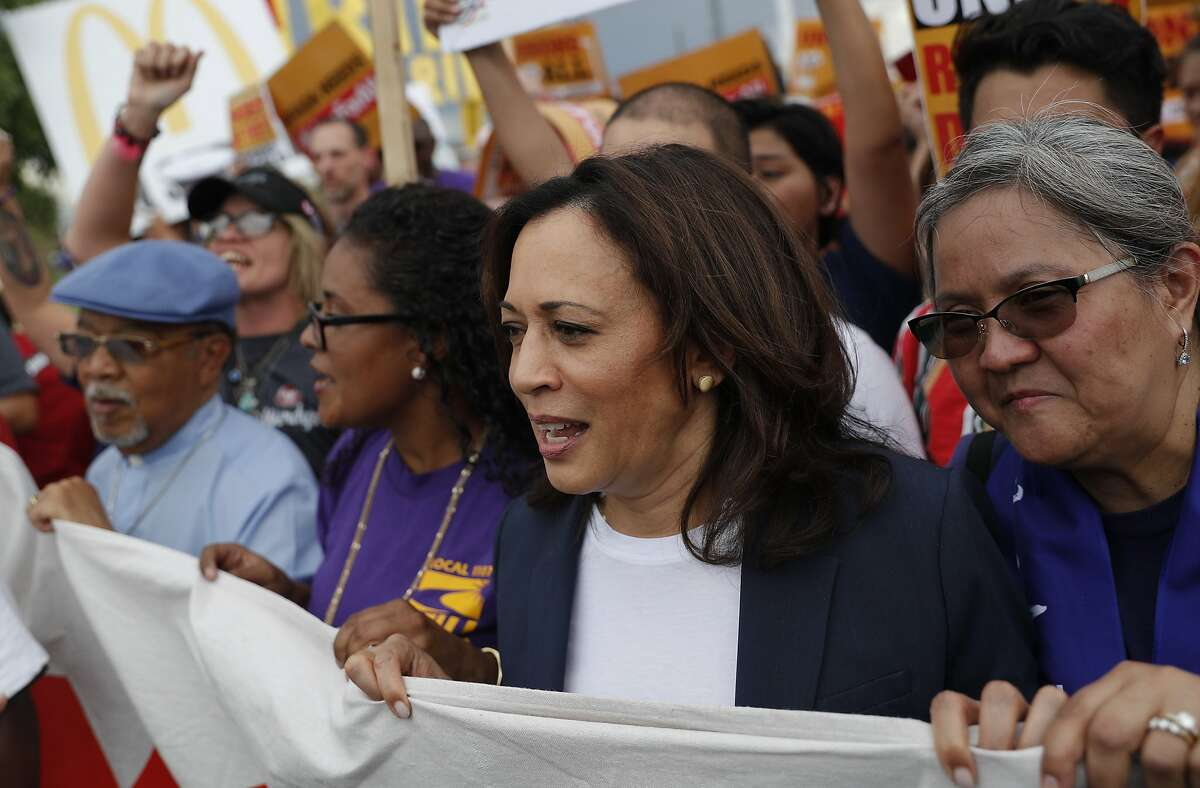 Democratic presidential candidate Sen. Kamala Harris, D-Calif., marches with rallies with McDonald's employees outside of a McDonald's, Friday, June 14, 2019, in Las Vegas. (AP Photo/John Locher)