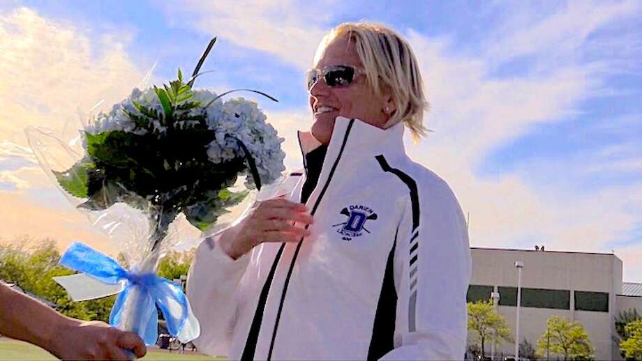 Lisa Lindley was given flowers and a new Wave warm-up jacket to mark the milestone at Norwalk High on Wednesday.