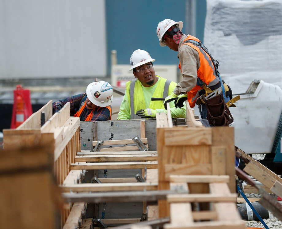 Construction workers at The Museum of Fine Arts, Houston, in January. Harris County's population slowed in 2018, growing at less than half its annual average rate amid slumping domestic migration and stricter immigration policies. Photo: Karen Warren Houston Chronicle