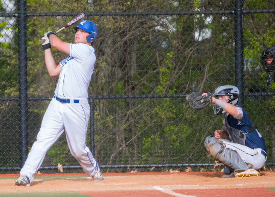 Casey Brown belts one out of the park, and into the parking lot, at Darien on Thursday. Courtesy Darien Athletic Foundation / (c)Mark Maybell