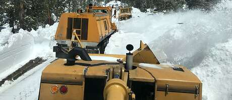 Three rotary-style snow removal rigs blow snow from Tioga Road this spring at Yosemite National Park