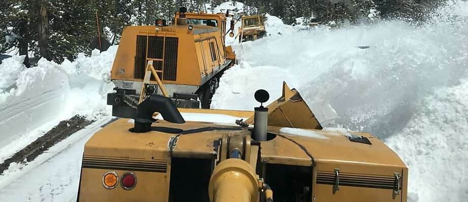 Three rotary-style snow removal rigs blow snow from Tioga Road this spring at Yosemite National Park Photo: Tom Stienstra / Courtesy Yosemite National Park
