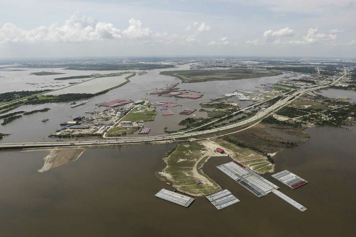 The San Jacinto River Waste Pits Superfund Site sits under floodwater as members of the Army National Guard travel to Beaumont in Chinook helicopters to deliver hay to cattle stranded by Tropical Storm Harvey Tuesday, Sept. 5, 2017.