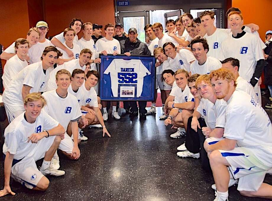 THE MOSTEST — Who's won the most games as coach in CT? It's a no-Brameier: Darien Coach B (middle), given a plaque by the town and team to honor the record-breaking season on Tuesday.