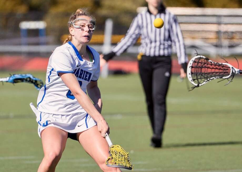 Emma Jaques fires off a shot in early season action. Courtesy Darien Athletic Foundation / (c)Mark Maybell