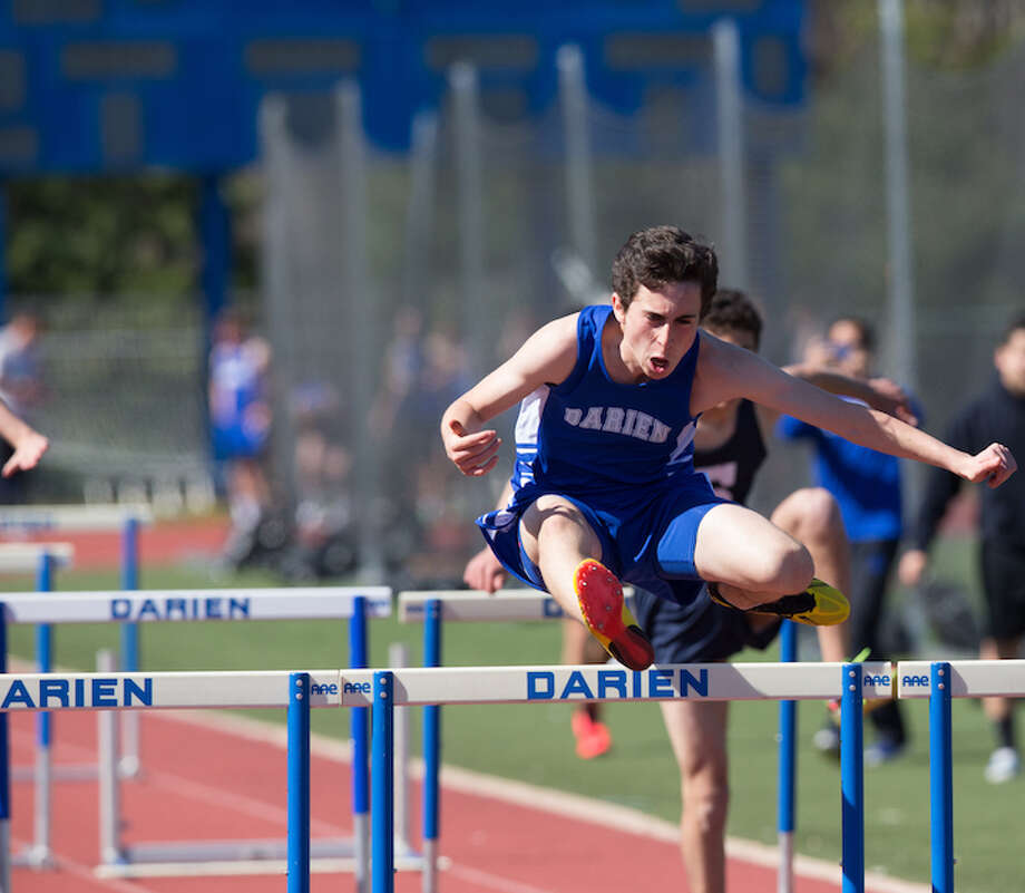 Ari Singer-Freeman is up and over it in 2016. He leads hurdles in 2017. Courtesy Darien Athletic Foundation / (c)Mark Maybell