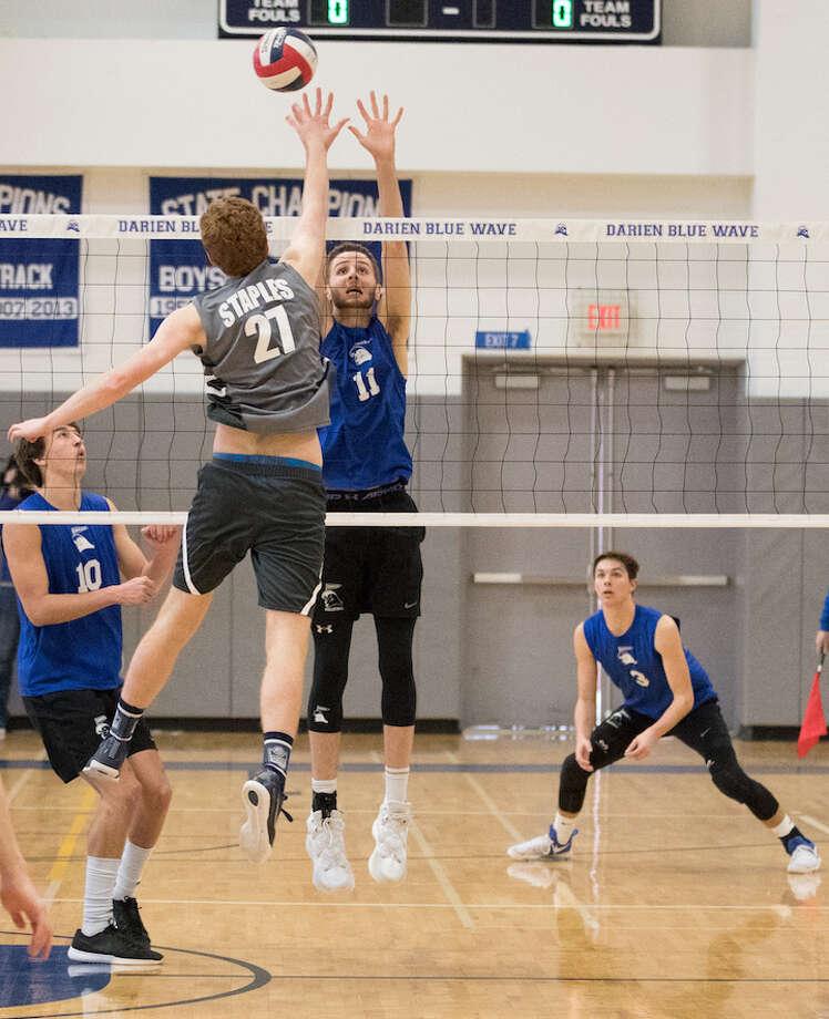 Alex Preston skies at the net. Courtesy Darien Athletic Foundation / (c)Mark Maybell