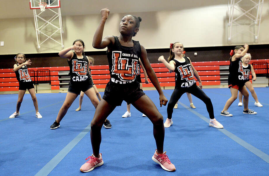 Alannah Felton and fellow campers run through a routine on the final day of Lamar University's annual dance and cheer camp Wednesday. The 3-day camp for children ages 5 - 14 pairs the group with Lamar's cheerleaders, dancers and staff to learn routines and techniques. The camp wrapped with a performance for friends and family. Photo taken Wednesday, June 19, 2019 Kim Brent/The Enterprise Photo: Kim Brent/The Enterprise