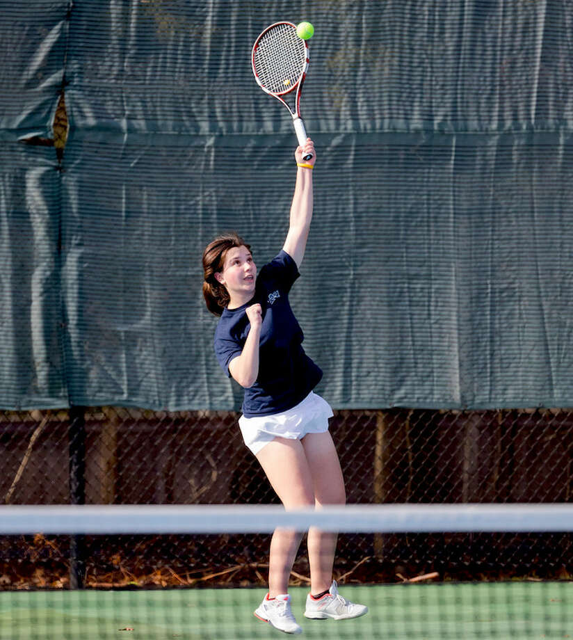 Wave No. 1 senior Kateri Martin reaches for the sky. Courtesy Darien Athletic Foundation / (c)Mark Maybell