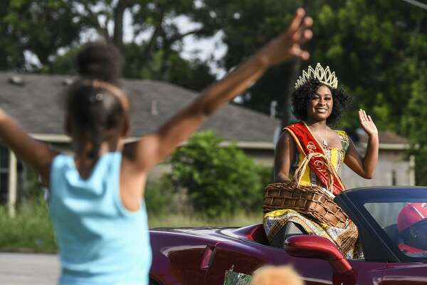 Asa Lewis, the 2018-19 CavOILCade Queen, waves to people on the sides of the street during the Port Arthur's Juneteenth Parade on Stillwell Boulevard Wednesday evening. Photo taken on Wednesday, 06/19/19. Ryan Welch/The Enterprise