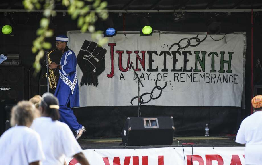 Evan Dominic, 2016's Mr. Juneteenth, practices with his saxophone during Port Arthur's Juneteenth in Barbara Jacket Park Wednesday evening. Photo taken on Wednesday, 06/19/19. Ryan Welch/The Enterprise Photo: Ryan Welch/The Enterprise