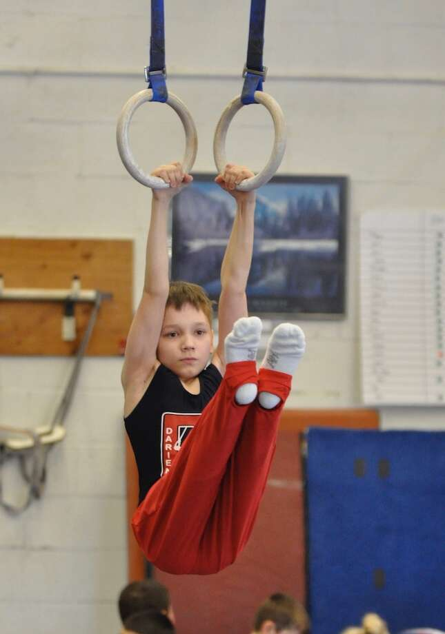 Egor Vasilyev scored 10.0 to win the rings title for his age group at the CT Level 4 State Championship meet.