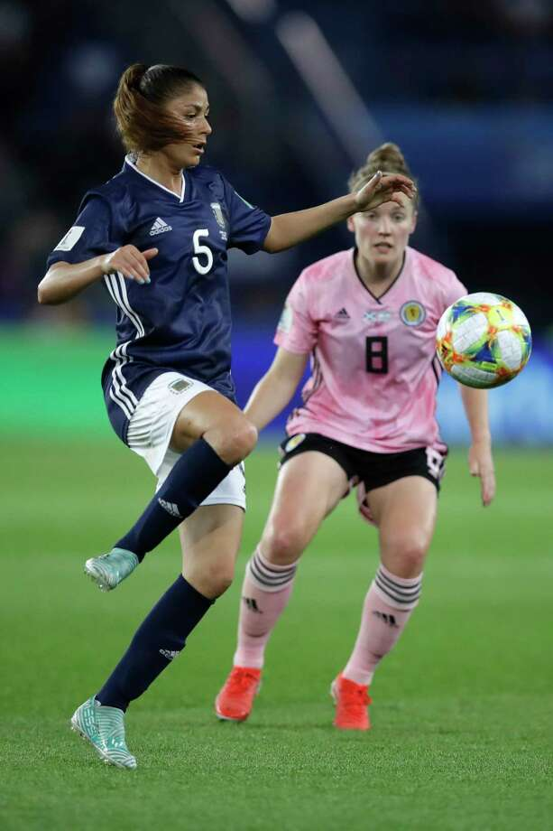 Argentina's Vanesa Santana, left, kicks the ball next to Scotland's Kim Little during the Women's World Cup Group D soccer match between Scotland and Argentina at Parc des Princes in Paris, France, Wednesday, June 19, 2019. (AP Photo/Alessandra Tarantino) Photo: Alessandra Tarantino / Copyright 2019 The Associated Press. All rights reserved