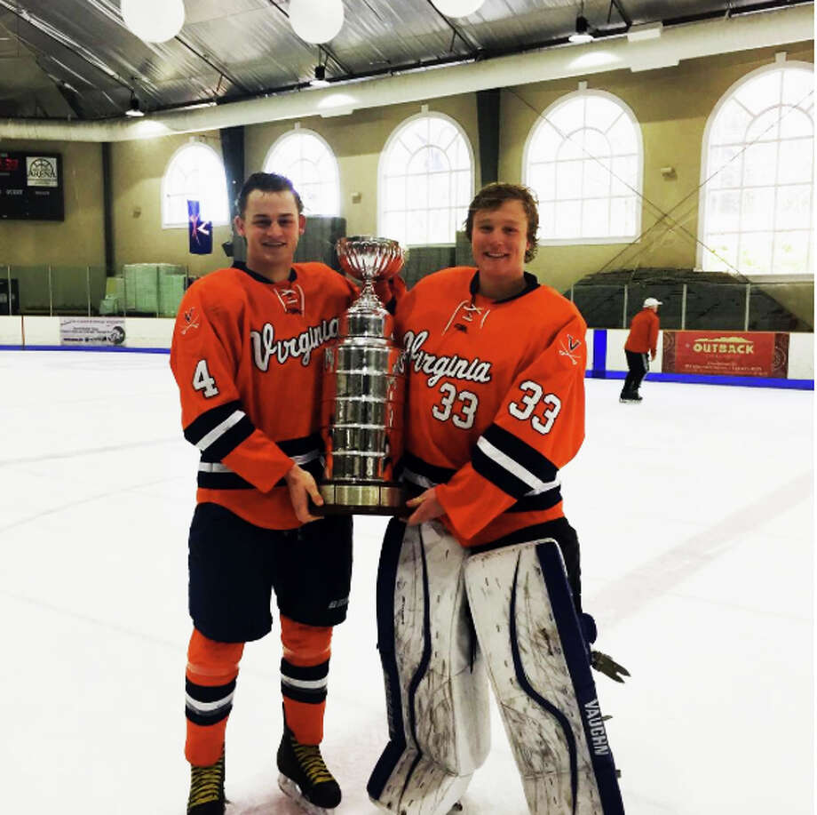 Teammates again, Nic Tuzinkiewicz (left) and David Voigt with the ACCHL trophy last month.
