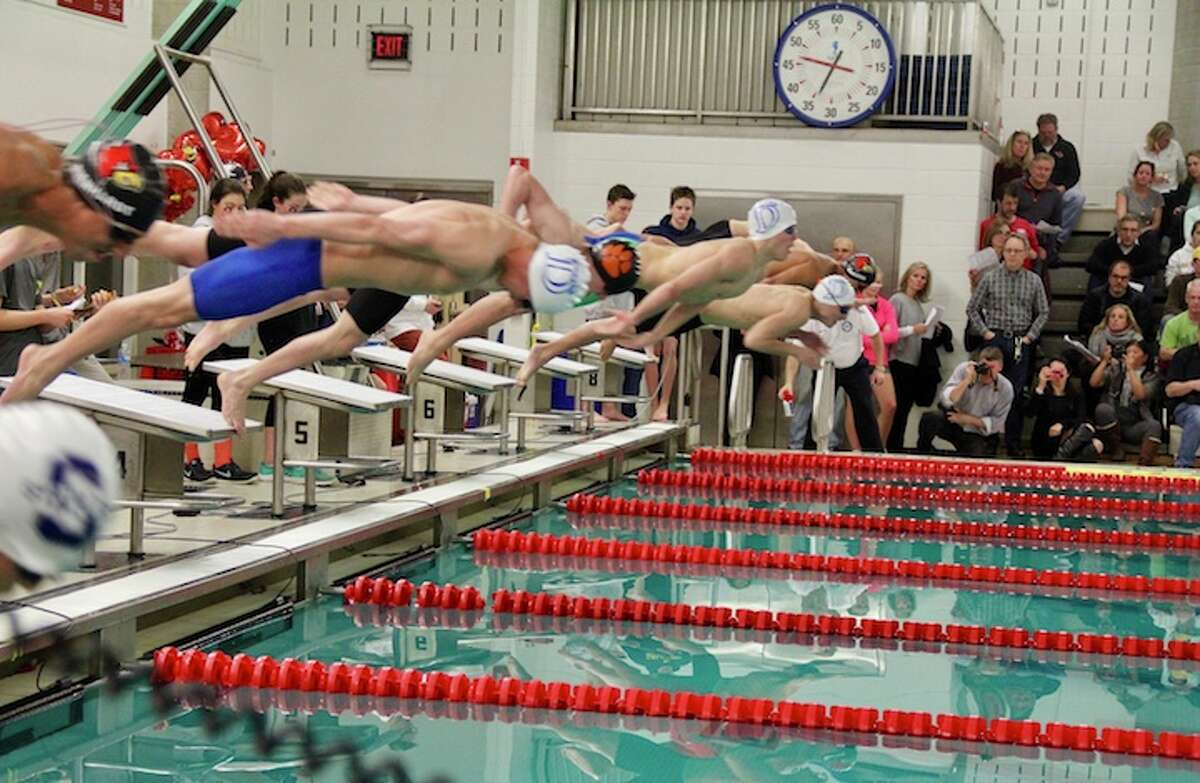 Wave swimmers from left, Alex Dehmel, Kevin Grune and John Barsanti start the breast stroke.