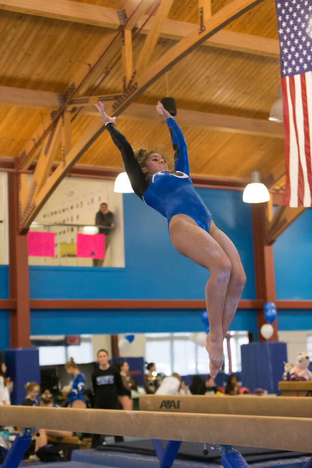 Sam Aparicio's scores have risen on beam over the course of the post-season. Courtesy Darien Athletic Foundation / (c)Mark Maybell