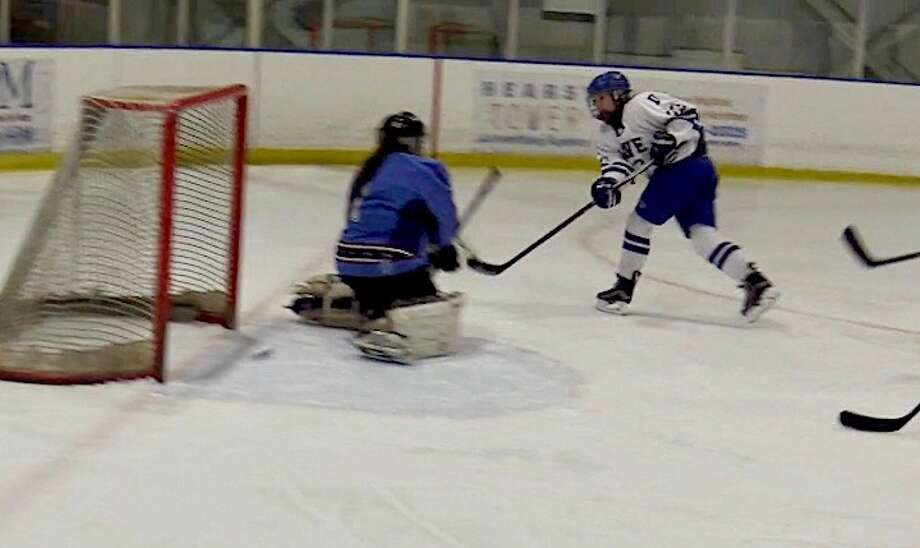 Junior KiKi Tropsa beats the goalie between the pads in double overtime at Shelton on Thursday.