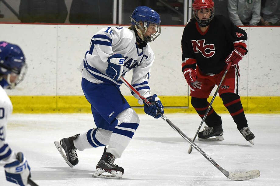 Darien's Shea van den Broek skates into the offensive zone during the Wave's game against rival New Canaan at the Darien Ice House on Monday, Dec. 17. — Dave Stewart photo
