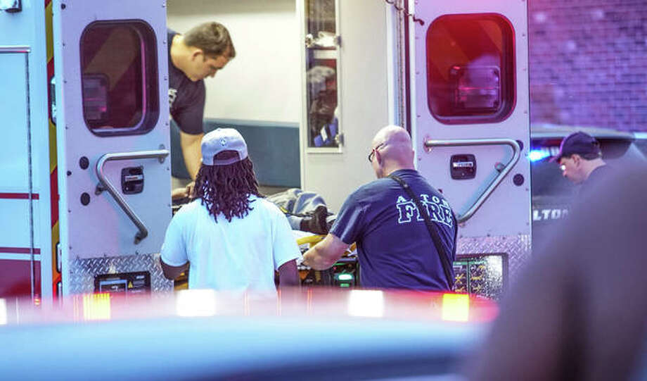 The victim of gunfire in Oakwood Estates Wednesday night is loaded into an ambulance. Photo: Nathan Woodside | The Intelligencer